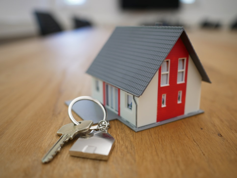 Model house next to a set of keys